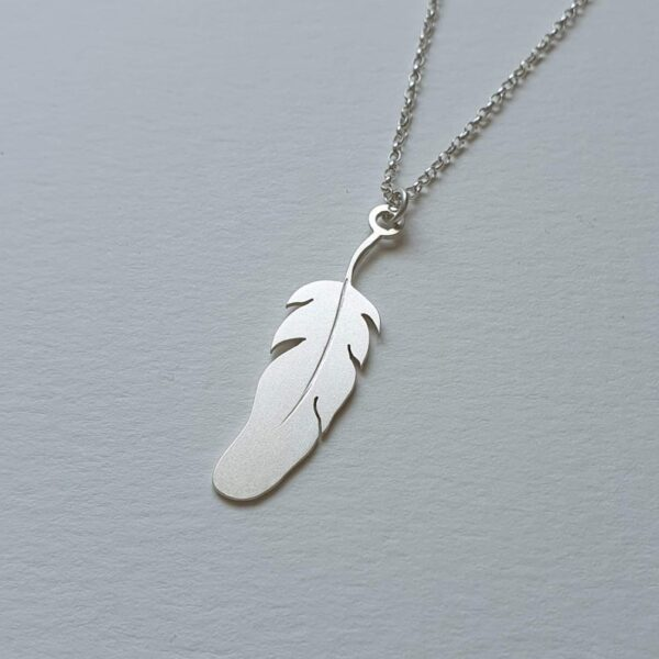 feather shaped silver locket